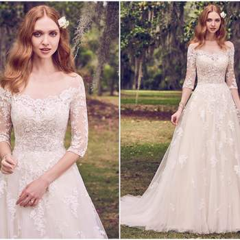 "Romantic lace motifs cascade over tulle in this illusion, off-the-shoulder, A-line wedding dress. Lace motifs complete the illusion portrait neckline, illusion half-sleeves, and illusion back. Finished with covered buttons over zipper closure.   <a href=""https://www.maggiesottero.com/maggie-sottero/bree/11160?utm_source=zankyou&amp;utm_medium=gowngallery"" target=""_blank"">Maggie Sottero</a>"