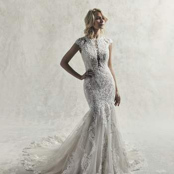 This sophisticated fit-and-flare wedding dress features cascades of beaded lace motifs and Swarovski crystals over tulle.