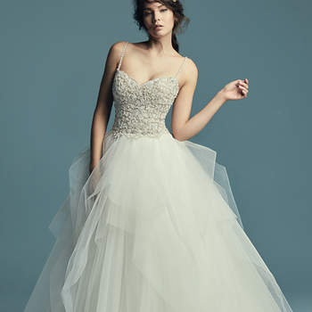 "<a href=""https://www.maggiesottero.com/maggie-sottero/shauna/11505"">Maggie Sottero</a>  This elegant princess wedding dress features a beaded bodice with Swarovski crystals atop a tiered tulle ballgown skirt. Beaded spaghetti straps complete the subtle sweetheart neckline. Finished with crystal buttons over zipper closure."