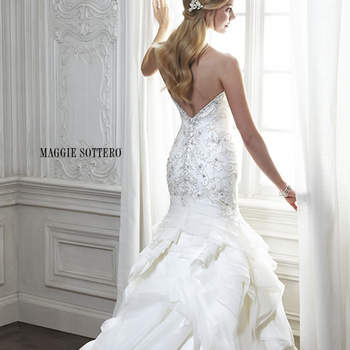 "Venice organza is artfully draped into this luxurious fit and flare wedding dress, featuring a decadent embroidered bodice with Swarovski crystals and romantic sweetheart neckline. Finished with crystal button over zipper and inner elastic closure.  <a href=""http://www.maggiesottero.com/dress.aspx?style=5MT153"" target=""_blank"">Maggie Sottero Spring 2015</a>"