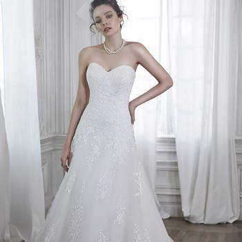 "Timeless romance is found in this tulle A-line wedding dress, complete with lace appliqués cascading down a lace embroidered hemline, and subtle sweetheart neckline. Finished with covered button over zipper and inner elastic closure.  <a href=""http://www.maggiesottero.com/dress.aspx?style=5MB026"" target=""_blank"">Maggie Sottero Spring 2015</a>"