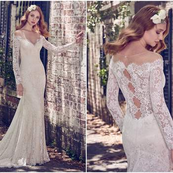 "Sheer lace comprises the illusion off-the-shoulder neckline and illusion long sleeves in this elegant lace wedding gown. A sheer lace back features a cascade of keyholes and a soft godet in the fit-and-flare skirt, while pearls cascade lightly down the front. Finished with pearl buttons and zipper closure.   <a href=""https://www.maggiesottero.com/maggie-sottero/megan/11178?utm_source=zankyou&amp;utm_medium=gowngallery"" target=""_blank"">Maggie Sottero</a>"