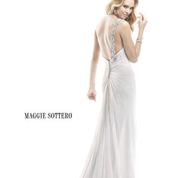 "All eyes will be on you as you walk down the aisle wearing this Aurora Chiffon gown. Accented with Swarovski crystals dancing alone the shoulder line, ruched chiffon drapes to a sparkling crystal motif at the hip, before cascading into a loose skirt. Finished with zipper back closure.  <a href=""http://www.maggiesottero.com/dress.aspx?style=4MD889"" target=""_blank"">Maggie Sottero Platinum 2015</a>"