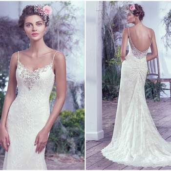 "Understated elegance is found in this allover lace sheath wedding dress. Delicate beaded spaghetti straps and sweetheart neckline embellished with pewter embroidery, Swarovski crystals, pearls and beads add a sophisticated twist to this classic silhouette. Complete with a low scoop illusion lace back. Finished with crystal buttons over zipper closure.   <a href=""https://www.maggiesottero.com/maggie-sottero/kaari/9717"" target=""_blank"">Maggie Sottero</a>"