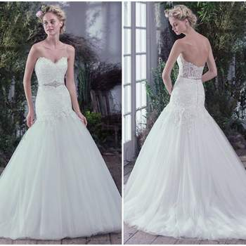 "Ultra-feminine and exquisitely graceful, this drop waist fit and flare wedding dress, with unembellished lace bodice and sweetheart neckline, is finished with a beaded belt. An illusion lace back and voluminous tulle skirt add touches of grandiose romance. Finished with pearl buttons over zipper closure. Beaded motif on tulle belt featuring Swarovski crystals sold separately.  <a href=""https://www.maggiesottero.com/maggie-sottero/oksana/9712"" target=""_blank"">Maggie Sottero</a>"