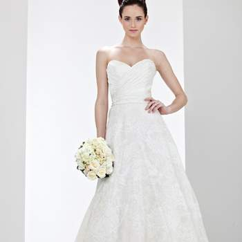 """<a title=""""Vestido da Semana"""" href=""""https://www.zankyou.pt/p/vestido-da-semana-desta-vez-nao-e-um-nem-sao-dois-mas-sim-tres"""" target=""""_blank"""">Saiba mais sobre o nosso vestido de noiva preferido desta colecção</a>"""