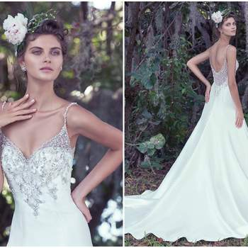 "Refined elegance is found in this embellished Elodie mikado A-Line wedding dress with a deep V-neckline. Glimmering Swarovski crystals generously adorn the fitted bodice, beaded spaghetti straps, and dramatic illusion back. Finished with crystal buttons over zipper closure.  <a href=""https://www.maggiesottero.com/maggie-sottero/kimberly/9686"" target=""_blank"">Maggie Sottero</a>"