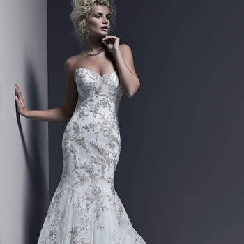 "A timeless and sophisticated style, this Chantilly lace fit and flare wedding dress is sweetened with lavish Swarovski crystal beaded lace motifs adorning the bodice and skirt, and edging the hemline. Finished with corset or covered buttons and zipper over inner corset back closure.   <a href=""http://www.sotteroandmidgley.com/dress.aspx?style=5SW615LU"" target=""_blank"">Sottero &amp; Midgley</a>"
