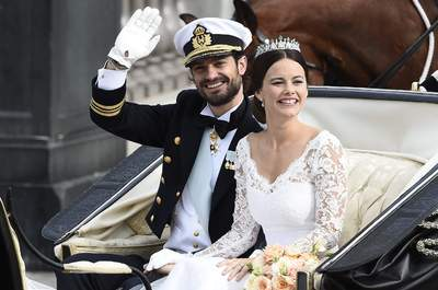 Swedish Prince Carl Philip and Sofia Hellqvist in an open carriage after their wedding ceremony at the Royal Place chapel in Stockholm, on Saturday 13rd June, 2015