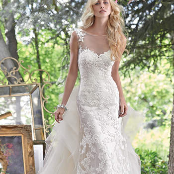 "Embroidered lace appliqués adorn this stunning sheath wedding dress, with a breathtaking illusion lace back. Finished with illusion sweetheart neckline and pearl buttons over zipper closure. Detachable train sold separately. <a href=""www.maggiesottero.com/maggie-sottero/jovi/9543"" target=""_blank"">Maggie Sottero</a>"
