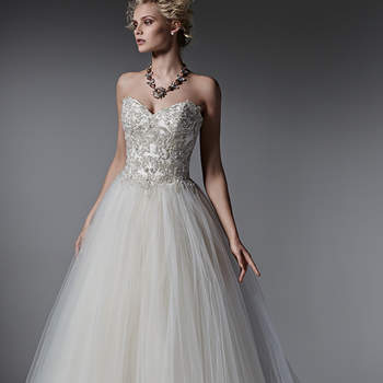 Whimsical layers of tulle create the skirt of this romantic ball gown wedding dress, while sparkling Swarovski crystals, pearls and beads adorn the bodice. Finished with sweetheart neckline and corset closure. <img height='0' width='0' alt='' src='http://ads.zankyou.com/mn8v' />