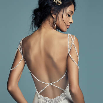 "<a href=""https://www.maggiesottero.com/maggie-sottero/gentry/11478"">Maggie Sottero</a>  Glamorous ribbons of Swarovski crystals and beading dance over the shoulders of this fit-and-flare wedding dress, completing the soft sweetheart neckline and scoop back with illusion keyhole detail. Comprised of Elodie Mikado for a vintage-inspired feel. Finished with zipper closure."