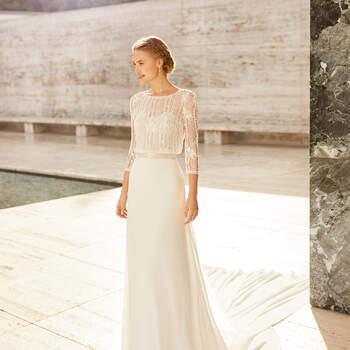 Escolher o vestido Eliot é ter um look glamoroso. Rico em detalhes, este luxuoso vestido com corpo de renda é ideal para cerimónias íntimas na igreja. | Rosa Clará Couture 2021