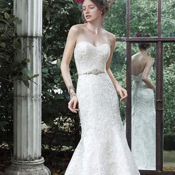 "Adorned in lace and accented with a timeless sweetheart neckline, this fit and flare wedding dress is for the truly romantic bride. Satin belt with beaded Swarovski crystal motif is offered separately. Finished with corset closure or covered buttons over zipper and inner corset closure.  <a href=""http://www.maggiesottero.com/dress.aspx?style=5MS643LU"" target=""_blank"">Maggie Sottero</a>"