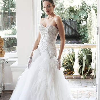 "Glittering Swarovski crystals and pearls adorn the fitted bodice of this wedding dress, while dramatic folds of tulle and Chic organza create the stunning, voluminous skirt. Finished with sweetheart neckline and corset closure.  <a href=""http://www.maggiesottero.com/dress.aspx?style=5MS668"" target=""_blank"">Maggie Sottero</a>"