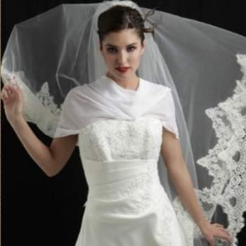 Voile de mariée Poésie en tulle, orné de dentelle de Clais. Crédit photo: Mariage Pronoce