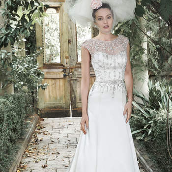 "Elegant glamour is found in this tulle and Shimmer satin A-line wedding gown, accented with an illusion neckline and cap-sleeves sprinkled with Swarovski crystals and pearls. Accented with a daring scoop back, edged in sparkling crystals. Finished with crystal buttons and zipper closure.  <a href=""http://www.maggiesottero.com/dress.aspx?style=5MW667SA"" target=""_blank"">Maggie Sottero</a>"