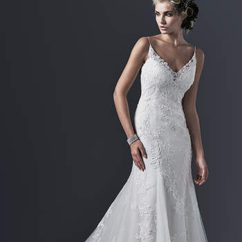 "Stunning simplicity is found in this embroidered lace and tulle wedding dress with slim A-line skirt. Elegant spaghetti straps give way to a daring, plunging back, edged with lace appliqués. Finished with V-neckline and covered buttons over zipper closure.    <a href=""http://www.sotteroandmidgley.com/dress.aspx?style=5SW692"" target=""_blank"">Sottero &amp; Midgley</a>"