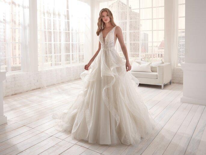 Vestido de novia corte princesa en tul y escote en V