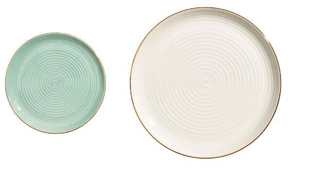 Vajilla verde y blanca con borde dorado. Credits: H&M Home