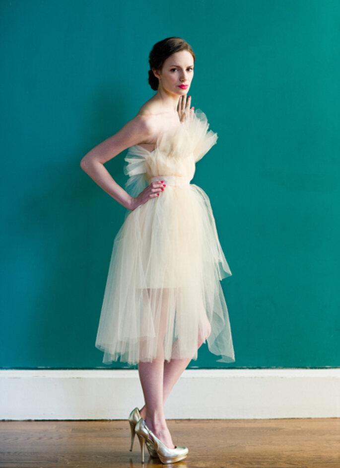 Vestido de noiva cor creme.