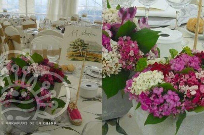 Flores como decoración para las mesas - Naranjas de la China