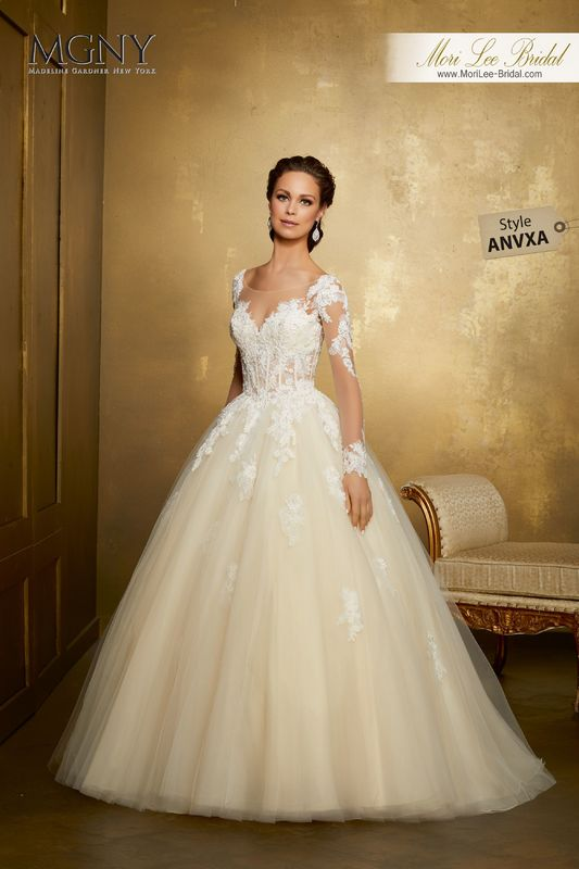 Style ANVXA Ortensia  Crystal beaded alençon and chantilly lace appliqués on a boned, corset bodice with a tull ball gown skirt  Matching satin bodice lining included