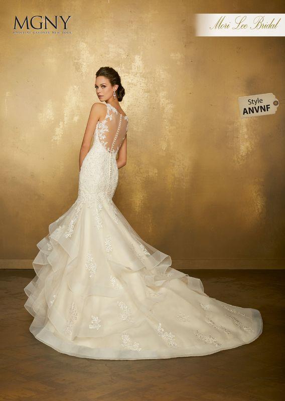 Style ANVNF Olivette  Crystal beaded, alençon lace appliqués over chantilly lace on a horsehair edged, flounced tulle mermaid