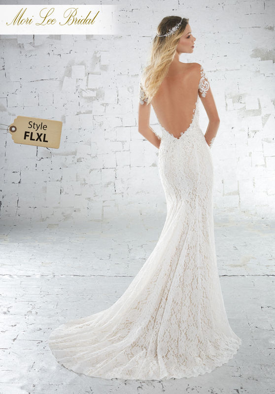 Style FLXL Karolina Wedding Dress  Beaded Alençon Lace Appliqués Accent the Sheer Neckline and Sleeves on This Allover Lace Sheath Gown. A Sheer Deep V Back and Chapel Length Train Complete the Look. Available in Three Lengths: 55″, 58″, 61″. Colors Available: White, Ivory, Ivory/Nude