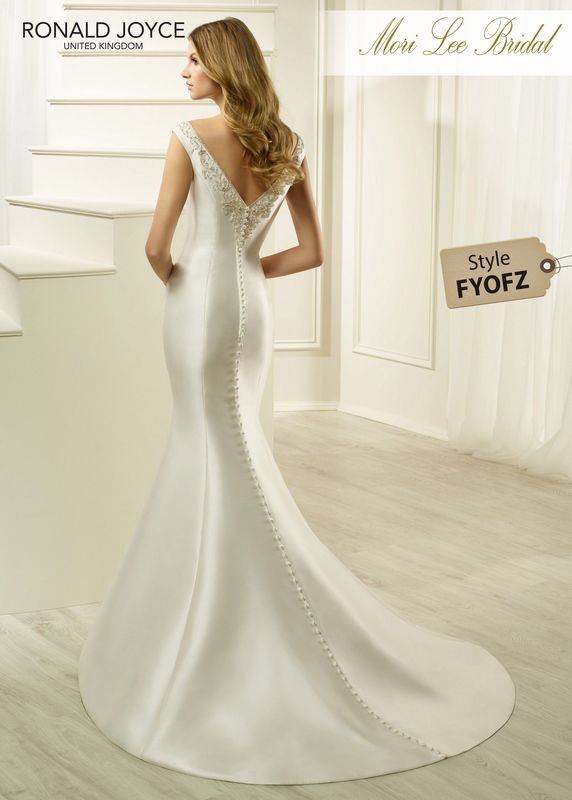 Style FYOFZ HELEN A FIT AND FLARE MIKADO GOWN WITH A BEADED V-NECKLINE AND BACK. PICTURED IN IVORY.  COLOURS WHITE, IVORY