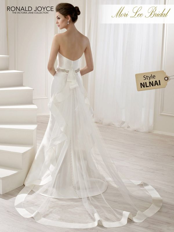 Style NLNAI LIDIA A STRAPLESS MIKADO FIT AND FLARE GOWN WITH BEADED BELT DETAIL AND DETACHABLE ORGANZA AND TULLE TRAIN. PICTURED IN IVORY.  COLOURS WHITE, IVORY