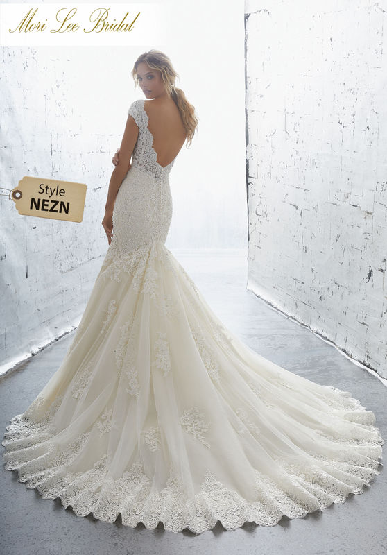 Style NEZN Karisma Wedding Dress  Romantic Crystal and Beaded, Alecon Lace Appliqués Accent the Bodice and Skirt on This Net Mermaid Gown. A Scalloped V Neckline and Wide Scalloped Hemline. Complete the Look. Available in Three Lengths: 55″, 58″, 61″. Colors Available: White, Ivory, Ivory/Champagne