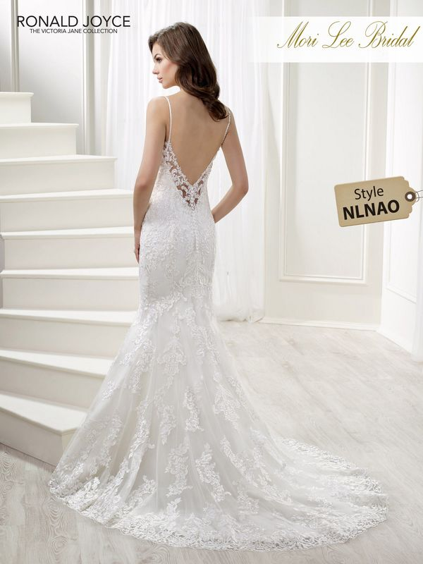 Style NLNAO LAVERINE A TULLE AND SATIN DRESS WITH LACE APPLIQUES. MATCHING SLEEVED JACKET INCLUDED. PICTURED IN IVORY.  AVAILABLE IN 3 LENGTHS: 55', 58' AND 61'   COLOURS WHITE, IVORY