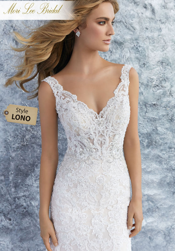 Style LONO  Kristina Wedding Dress  Elegant Fit and Flare Wedding Dress with Diamanté Beaded Appliqués on Crystallized Alençon Lace on Net. A Wide Scalloped Hemline and Open Back Trimmed in Covered Buttons Complete the Look. Available in Three Lengths: 55″, 58″, 61″. Colors Available: White, Ivory, Ivory/Crème