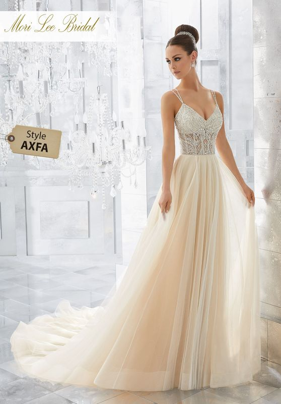 Style AXFA Misty Wedding Dress  Soft and Ethereal, This Silky Net Soft Ball Gown Features a Dazzling Crystal and Diamanté Beaded Sheer Bodice with Exposed Boning. Delicate Double Back Straps Complete the Look. Matching Satin Bodice Lining Included. Colors Available: White/Silver, Ivory/Silver,Ivory/Champagne Silver.