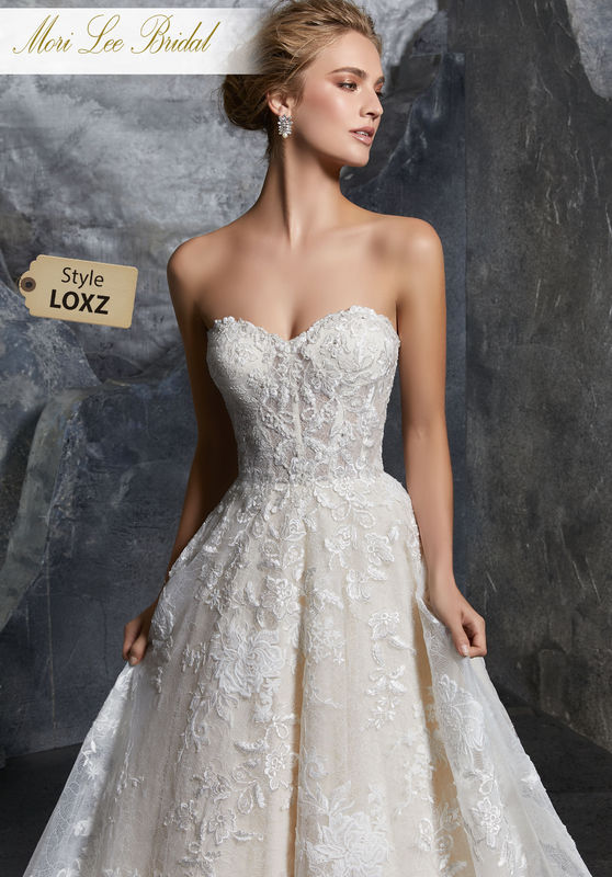 Style LOXZ  Katerina Wedding Dress  Chic Chantilly Lace Ball Gown Featuring Layers of Lace, with Beaded and Embroidered Appliqués. The Exposed Boned Sweetheart Bodice is Trimmed in Covered Buttons. Matching Satin Bodice Lining Included. Available in Three Lengths: 55″, 58″, 61″. Colors Available: White, Ivory, Ivory/Champagne