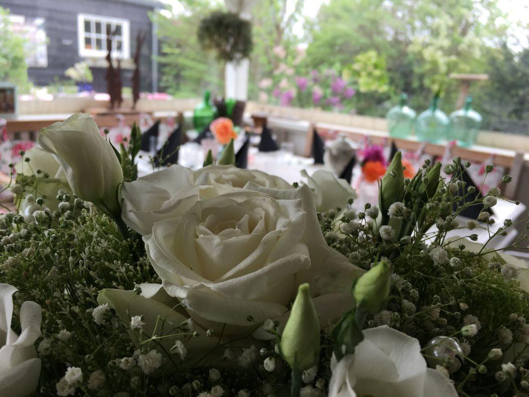 bloemdecoratie diner bruiloft