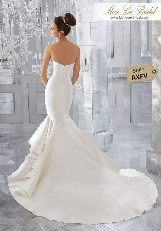 Style AXFV Merci Wedding Dress  Simple and Chic, This Marcella Satin Sculptured Mermaid Features a Romantic Sweetheart Neckline and Covered Button Detail Along the Back. Shown with Pearl and Diamanté Beaded Alençon Lace Jacket (not inlcuded), Sold Separately as Style NXOEA. Colors Available: White, Ivory.