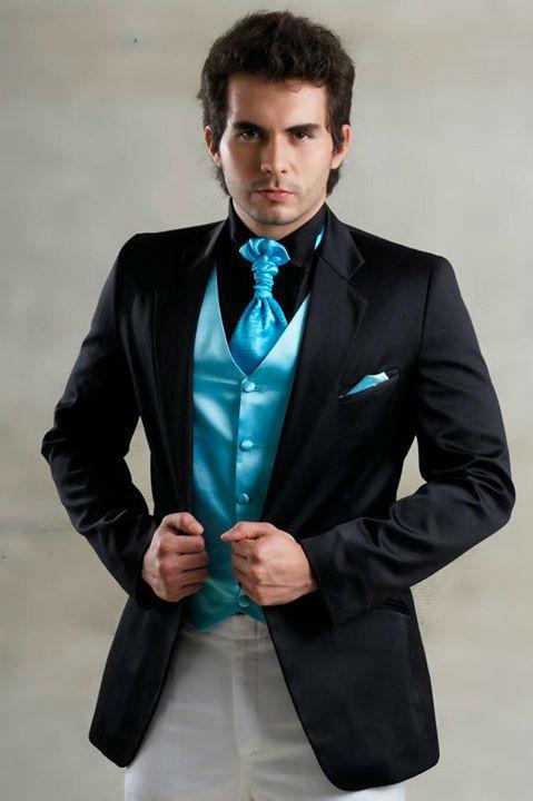 Traje negro con corbata y chaleco turquesa