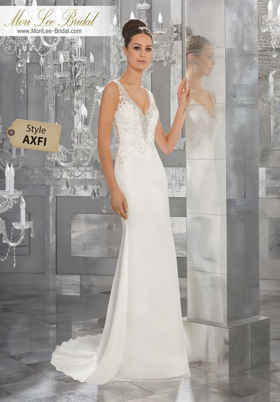 Style AXFI Myka Wedding Dress  Elegant Silky Chiffon Wedding Dress Featuring Diamanté Beaded Embroidery and Lace Appliqués Along the Deep-V Neckline and Illusion Back. Covered Button Detail Along Back. Colors Available: White/Silver, Ivory/Silver.