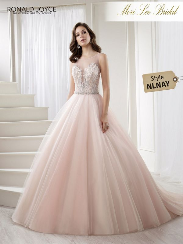Style NLNAY LAURENA A TULLE AND SATIN BALL GOWN WITH A UNIQUE BEADED BODICE AND DEEP V-BACK. PICTURED IN BLUSH/CHAMPAGNE AND IN IVORY.  COLOURS WHITE, IVORY, BLUSH/CHAMPAGNE