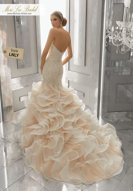 Style LNLY Mirjana Wedding Dress  Glamorous Mermaid Wedding Gown Featuring Crystal Beaded, Embroidered Lace Appliqués and a Circular Flounced Organza Skirt. Covered Buttons Along the Back Complete the Look. Available in Three Lengths: 55″, 58″, 61″. Colors Available: White, Ivory, Ivory/Light Gold.