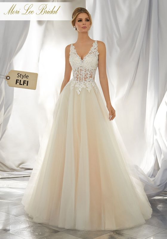 Style FLFI Myrcella Wedding Dress  A Classic Silhouette with a Touch of Trend. This Soft Tulle Ball Gown Features a Crystal Beaded, Re-Embroidered Sheer Bodice with Lace Appliqués and Soft Tulle Skirt. Matching Satin Bodice Lining Included. Colors Available: White, Ivory, Ivory/Light Gold.