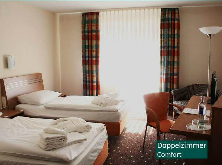 Beispiel: Doppelzimmer, Foto: Hotel Rheinsberg am See.