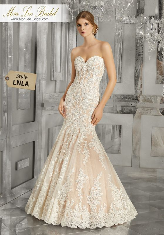 Style LNLA Morella Wedding Dress  This Stunning Mermaid Wedding Gown Features Crystal Beaded Alençon Lace Appliqués, Exposed Boning, and an Exquisite Scalloped Hemline. Shown with Removable Beaded Lace Shoulder Coverlet (not included), Sold Separately as Style NXOEL. Available in Three Lengths: 55″, 58″, 61″. Colors Available: White, Ivory, Ivory/Nude.