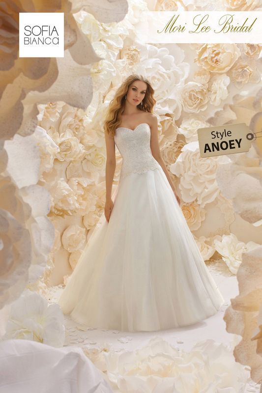 Style ANOEY A CLASSIC A-LINE DRESS WITH STRAPLESS DROPPED WAIST BODICE ON A SOFT TULLE SKIRT   COLOURS WHITE OR IVORY
