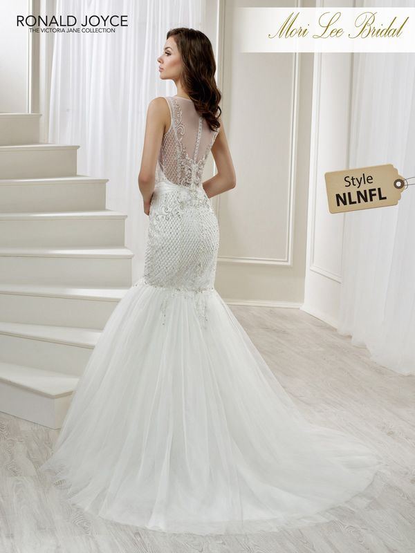 Style NLNFL LILLIAN A TULLE AND CHIFFON FISHTAIL DRESS WITH INTRICATE BEADED DETAIL AND AN ILLUSION NECKLINE/BACK. PICTURED IN IVORY.    COLOURS WHITE, IVORY