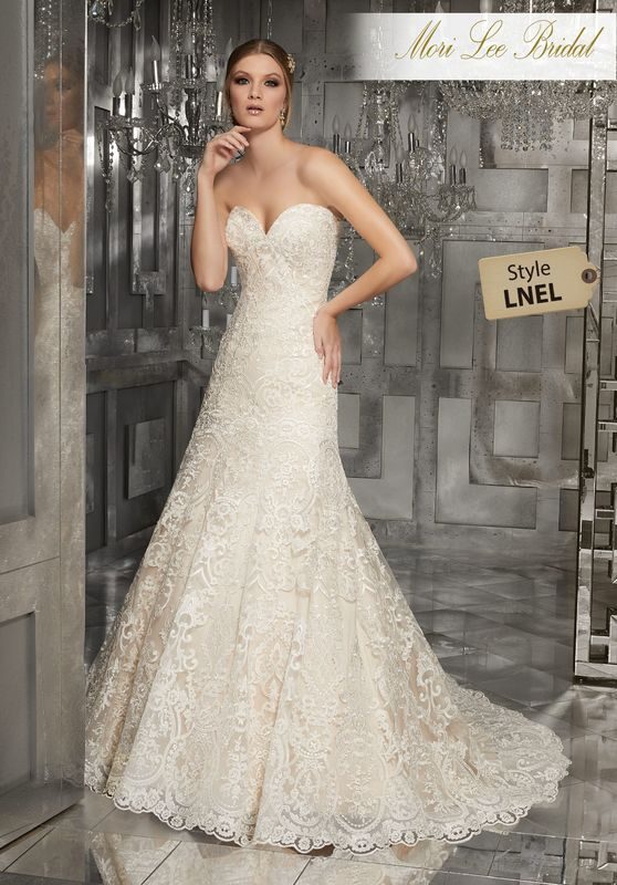 Style LNEL Monroe Wedding Dress  Lavish A-Line Gown with Sculptured, Re-Embroidered Lace and Scalloped Hemline Available in Three Lengths: 55″, 58″, 61″. Colors Available: White, Ivory, Ivory/Champagne.
