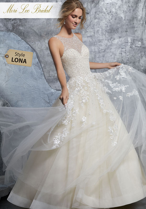 Style LONA  Kiara Wedding Dress  Classic Bridal Ballgown Featuring a Dazzling Crystallized Bodice on Tulle Skirt. Embroidered Appliqués and Horsehair Trim Accent the Skirt. Available in Three Lengths: 55″, 58″, 61″. Colors Available: White, Ivory, Ivory/Champagne