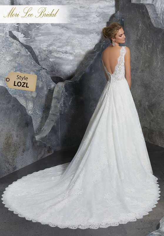 Style LOZL  Kelly Wedding Dress  Classic Bridal Ballgown Featuring a Scalloped V-Neck Bodice with Delicately Beaded and Embroidered Appliqués on Net Over Chantilly Lace. A Scalloped Deep V-Back Trimmed in Covered Buttons Compeltes the Look. Matching Satin Bodice Lining Included. Colors Available: White/Nude, Ivory/Nude